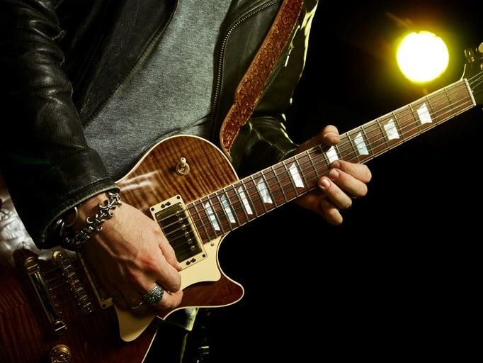 Guitarist performing a riff