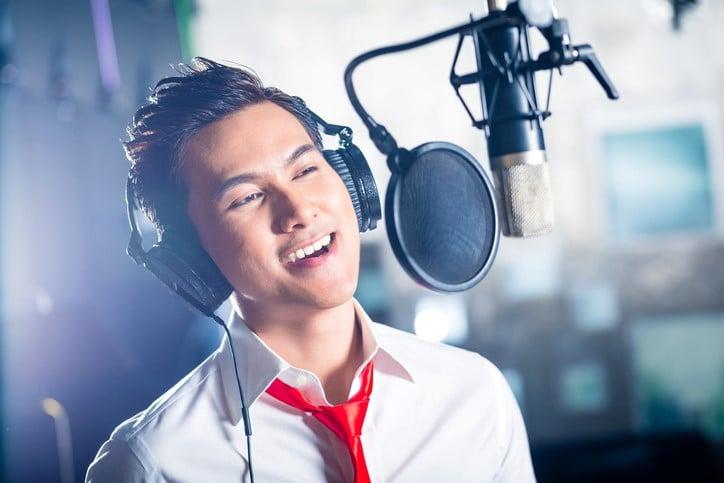 Vocalist in recording studio