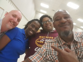 Scott Keiklak of AIMM and James Caldwell of MEG with Omarion Brown Maynard H. Jackson High School