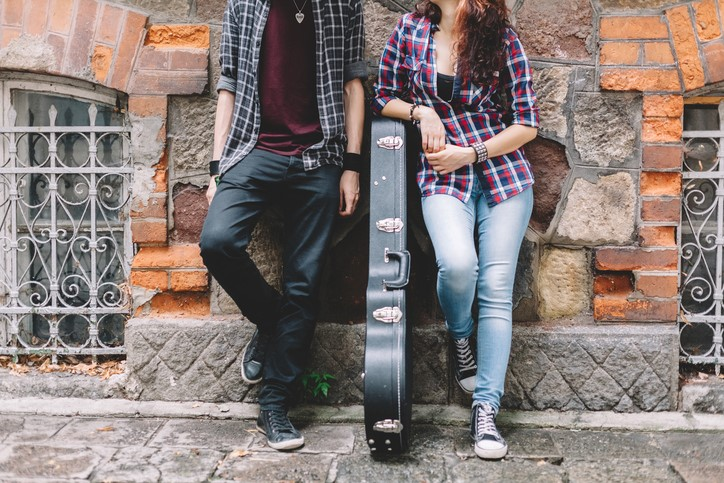 A couple attends the Atlanta Institute of Music and Media for guitar