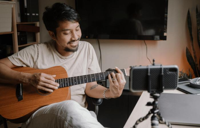 a guitarist livestreaming a performance