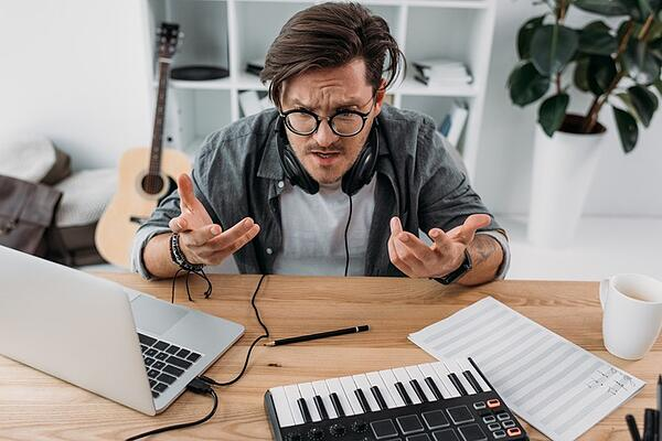 A musician experiencing frustration