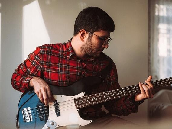 A BASS guitarist working on a riff in Wright