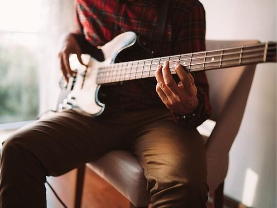 bass-guitarist-working-on-a-riff-in-red-oak