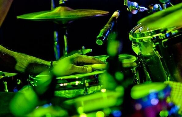 a-colbert-drummer-performing-on-stage