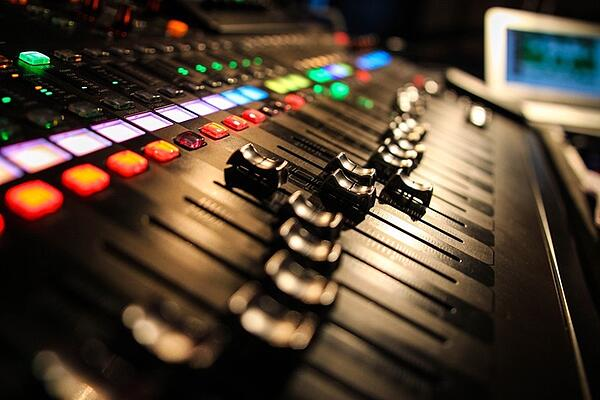 What are the responsibilities of a music producer?
